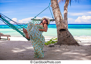 Young woman enjoying vacation in the hammock