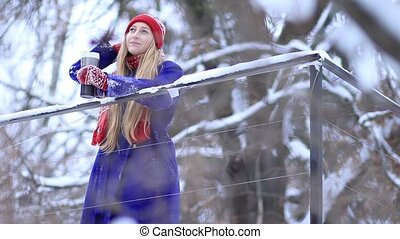 Young woman enjoying winter landscape
