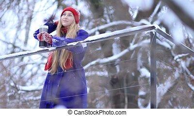 Young woman enjoying winter landscape