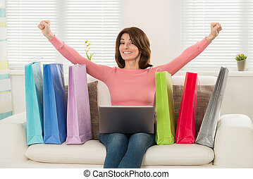 Woman Excited While Shopping Online