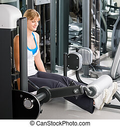 Young woman exercise legs at fitness center