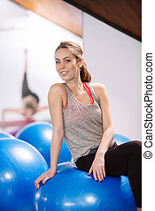 Young woman exercise with pilates balls