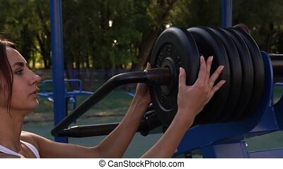 Young Woman Exercising in Outdoors Gym