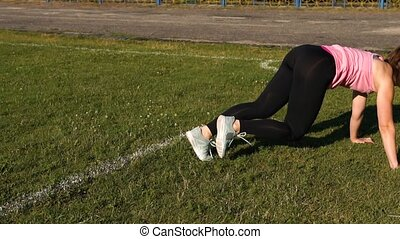 Young Woman Exercising Outdoors in Sunny Day