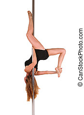 Young woman exercising pole dance fitness