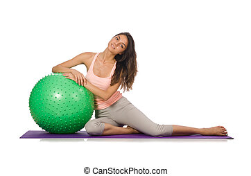 Young woman exercising with swiss ball