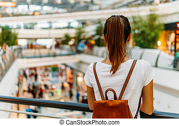 Young Woman Exploring Modern Shopping Mall