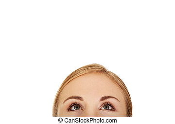 Young woman eyes looking up