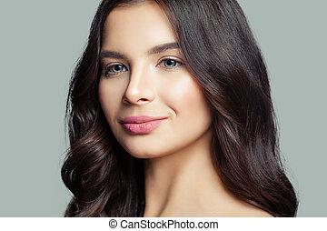 Young woman face closeup. Girl smiling