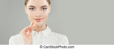 Young woman face on white banner background