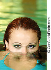 young woman face part under water