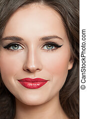 Young woman face with makeup closeup portrait