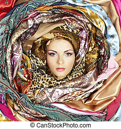 Young woman face with scarves. Close-up portrait
