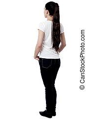 Young woman facing the wall