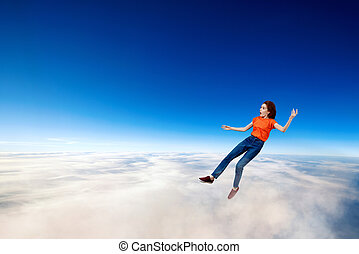 Young woman failed and falling down in clouds sea.