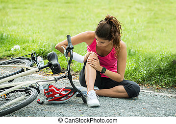 Young Woman Fallen From Bicycle - Young Woman With Pain In...