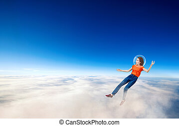 Young woman falling down from space in clouds sea.