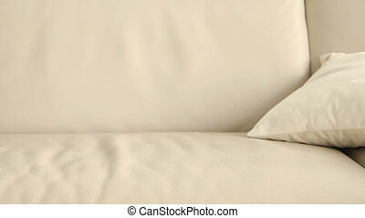 Young woman falling on sofa dead tired