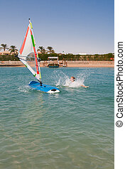 Young woman falls off the board for windsurfing in Egypt, Hurghada