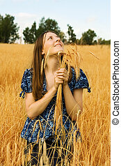 woman farmer with wheat