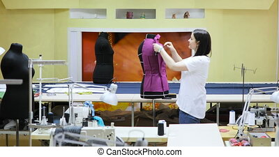 Young Woman Fashion Designer Works in Studio. Clothing...