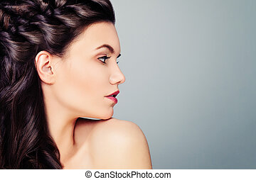 Young Woman Fashion Model. Female Profile on Blue Background