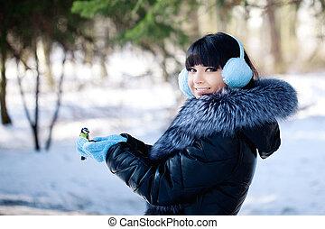 Young woman feeding winter birds