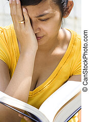 young woman feel dizzy during reading - asian young woman...