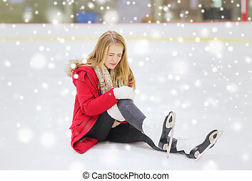 young woman fell down on skating rink - people, sport,...