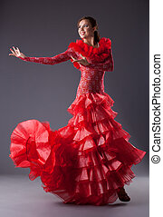 young woman flamenco dancer posing in red