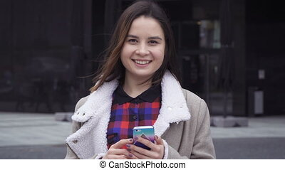 Young woman flipping a smart phone
