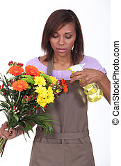 Young woman florist on white background