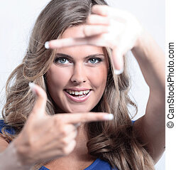 Young woman frame her face with hands