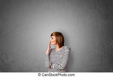 Young woman gesturing with copy space