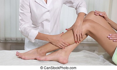 Young woman gets a foot massage in the spa salon.