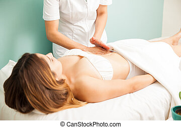 Young woman getting a lymphatic massage