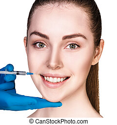 Young woman getting cosmetics injection.