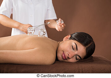 Young Woman Getting Cupping Treatment