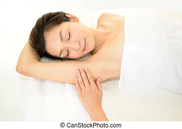 Young woman in Spa getting hair removal