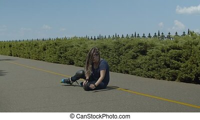 Young woman getting injured while rollerblading - Active...