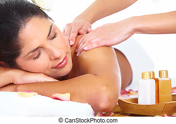Young woman getting massage in spa salon.
