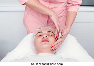 Young woman getting spa treatment at beauty salon