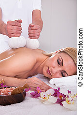 Young Woman Getting Spa Treatment