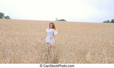 Young woman girl in white dress running on the Field