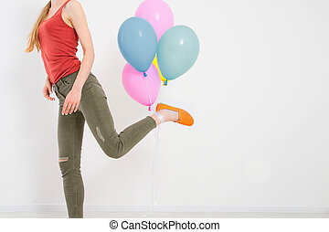 young woman girl running with colored balloons isolated on white background. Copy space