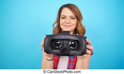 Young Woman give virtual reality goggles - Girl give virtual...