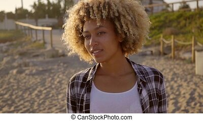 Young Woman Gives Air Kiss. - Young mixed-race woman make a...