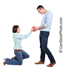 Young woman giving present to her boyfriend