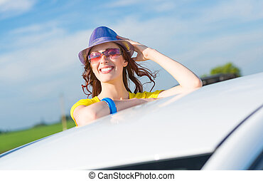 Young woman got out of car window