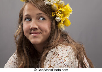 Young Woman Grinning - A young woman with flowers in her ...